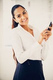 Indian business woman using mobile phone happy Royalty Free Stock Image
