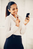 Indian business woman using mobile phone Royalty Free Stock Photo