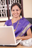 Indian business woman working on laptop Stock Photography