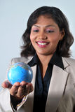 Indian Business woman with the world in her hands Stock Photography