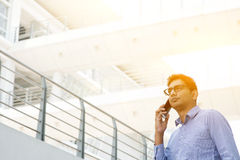 Indian businessman calling on smartphone Stock Photos