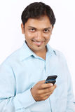 Indian Businessman with Cell Phone Royalty Free Stock Photography