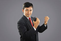 Indian Businessman with Cellphone Royalty Free Stock Photography