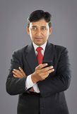 Indian Businessman with Cellphone Royalty Free Stock Image