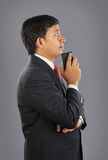 Indian Businessman with Cellphone Stock Images