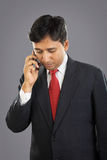 Indian Businessman with Cellphone Stock Photo
