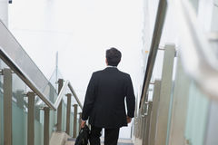 Indian businessman descending steps Royalty Free Stock Images