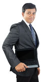 Indian Businessman Holding Laptop Stock Photography