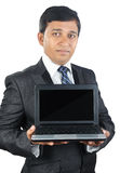 Indian Businessman holding a Laptop Royalty Free Stock Images