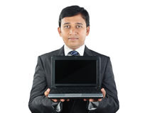 Indian Businessman holding Laptop. Indian Young Businessman holding Laptop Stock Image