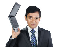 Indian Businessman holding a Laptop. Indian Young Businessman Holding a Laptop with Smile Royalty Free Stock Photo