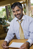 Indian Businessman Holding Paper Royalty Free Stock Photo