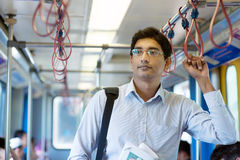 Indian businessman inside train. Stock Photography
