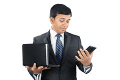 Indian Businessman with Laptop and Tablet Royalty Free Stock Images