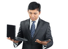 Indian Businessman with Laptop and Tablet Stock Images