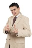 Indian businessman making hand gesture Royalty Free Stock Images