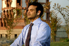 Indian Businessman meditating Stock Image