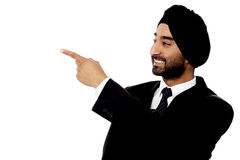 Indian businessman pointing away Stock Image