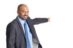 Indian businessman pointing away Royalty Free Stock Images