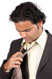 Indian Businessman Removing Tie Stock Photos