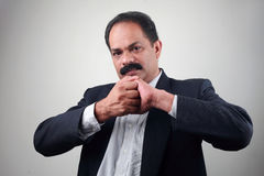 Indian businessman shows achievement gesture Stock Photos