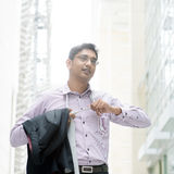 Indian businessman taking off his tie Royalty Free Stock Images