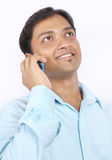 Indian businessman talking on cellphone Stock Image