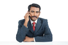 Indian businessman talking on cellphone Stock Photos