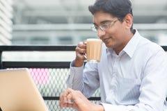 Indian businessman tea break Royalty Free Stock Photo