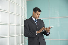 Indian businessman using his digital Tablet. Royalty Free Stock Image