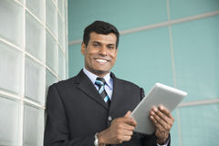 Indian businessman using his digital Tablet. Royalty Free Stock Photography