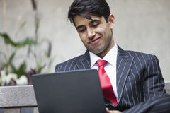 An Indian businessman using tablet PC Royalty Free Stock Photos