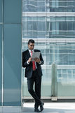Indian businessman using a tablet PC indoors Royalty Free Stock Photo