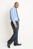 Indian businessman walking Royalty Free Stock Photos