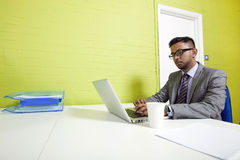 Indian businessman working at his desk Stock Photos