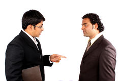 Indian Businessmen Meeting. Two young Indian businessman in a business discussion, on white studio background Stock Photo
