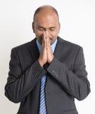 Indian businesspeople praying Stock Image