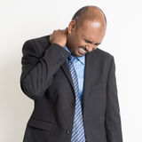 Indian businesspeople shoulder pain Stock Images