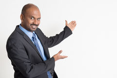 Indian businesspeople showing Stock Images