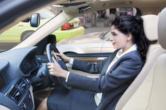 Indian businesswoman driving her car Royalty Free Stock Photo