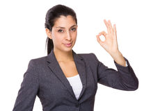 Indian businesswoman with ok sign gesture Royalty Free Stock Image