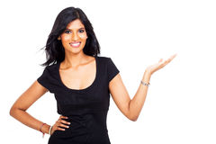 Indian businesswoman presenting. Smiling indian businesswoman presenting on white background Stock Photo