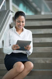 Indian Businesswoman reading her digital tablet. Stock Images