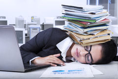 Indian businesswoman sleeping in office Royalty Free Stock Photo
