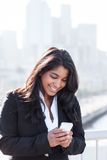Indian businesswoman texting on the phone Stock Photo