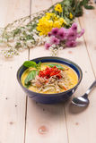 Indian Butter chicken curry with basil leaves. On wood base Royalty Free Stock Photography
