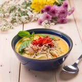 Indian Butter chicken curry with basil leaves. On wood base Royalty Free Stock Photo