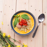 Indian Butter chicken curry with basil leaves. On wood base Stock Image