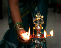 Indian candles. Lighting of candles at indian ceremony Stock Photography