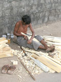 Indian carpenter making cricket bats Royalty Free Stock Photos